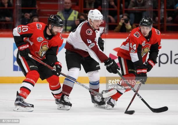 Tom Pyatt and JeanGabriel Pageau of the Ottawa Senators defend against Tyson Barrie of the Colorado Avalanche at Ericsson Globe on November 11 2017...