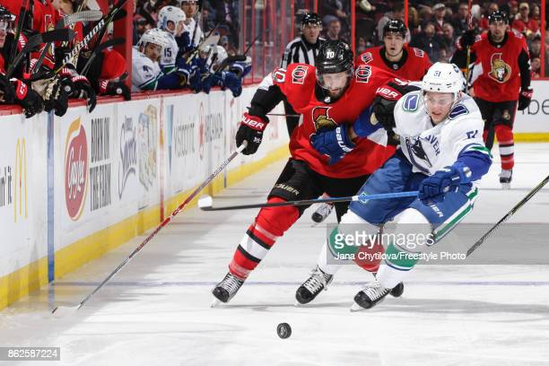 Tom Pyatt of the Ottawa Senators battles for the puck against Troy Stecher ofthe Vancouver Canucks in the second period at Canadian Tire Centre on...