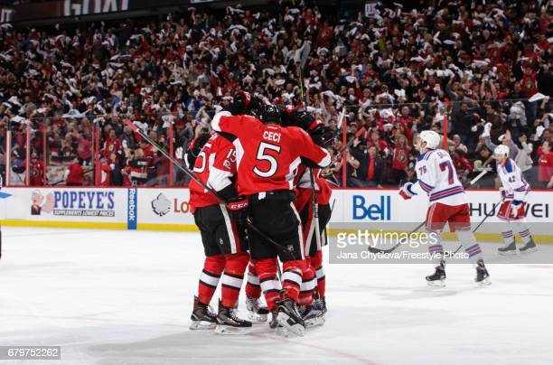 Tom Pyatt of the Ottawa Senators celebrates his second period goal against the New York Rangers with teammates Cody Ceci and Zack Smith in Game Five...