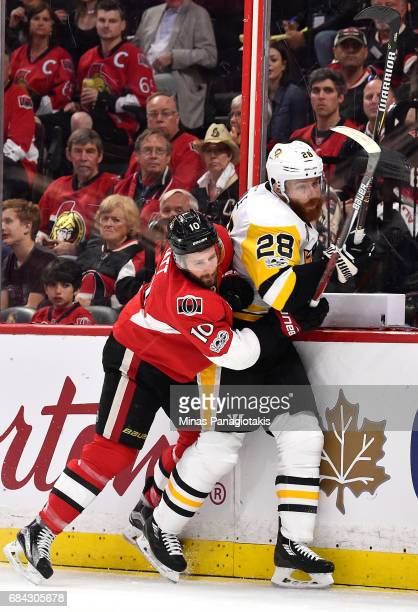 Tom Pyatt of the Ottawa Senators checks Ian Cole of the Pittsburgh Penguins during the first period in Game Three of the Eastern Conference Final...