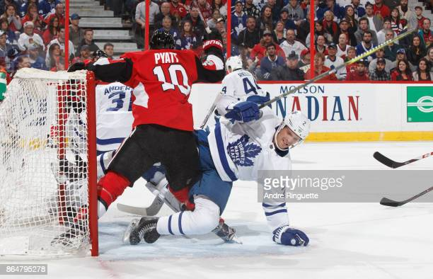 Tom Pyatt of the Ottawa Senators collides with Ron Hainsey of the Toronto Maple Leafs at the crease at Canadian Tire Centre on October 21 2017 in...