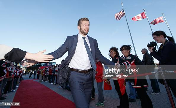 Tom Pyatt of the Ottawa Senators walks down the red carpet prior to a game against the Toronto Maple Leafs at Canadian Tire Centre during the season...