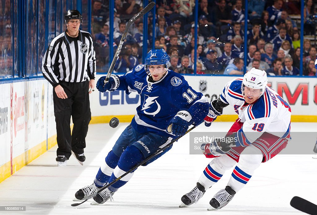 <a gi-track='captionPersonalityLinkClicked' href=/galleries/search?phrase=Tom+Pyatt&family=editorial&specificpeople=2079036 ng-click='$event.stopPropagation()'>Tom Pyatt</a> #11 of the Tampa Bay Lightning and <a gi-track='captionPersonalityLinkClicked' href=/galleries/search?phrase=Brad+Richards&family=editorial&specificpeople=202622 ng-click='$event.stopPropagation()'>Brad Richards</a> #19 of the New York Rangers fight to get control of the puck during the third period of their game at the Tampa Bay Times Forum on February 2, 2013 in Tampa, Florida.