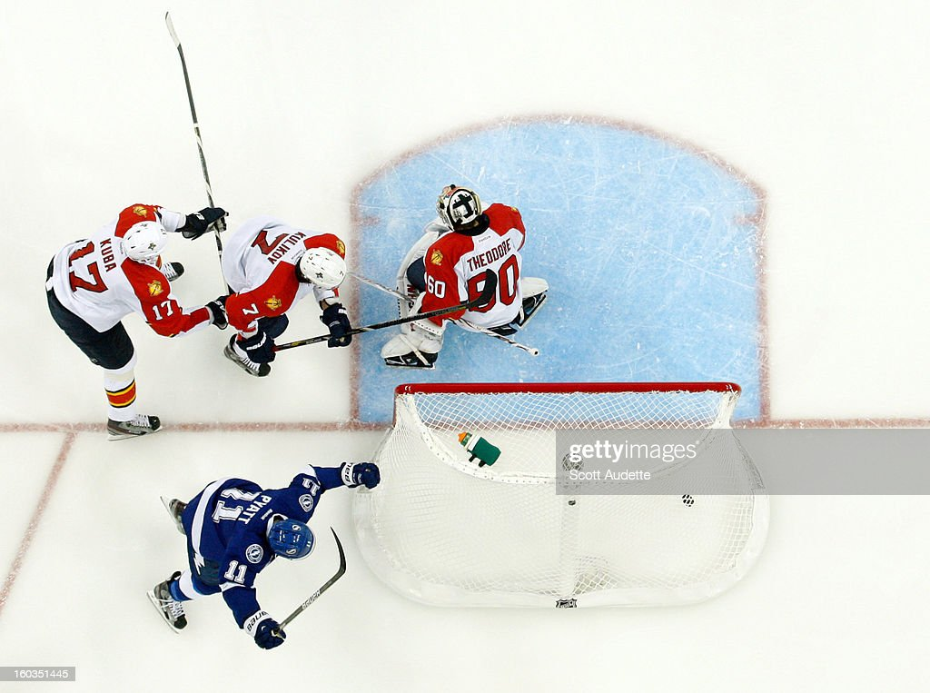 <a gi-track='captionPersonalityLinkClicked' href=/galleries/search?phrase=Tom+Pyatt&family=editorial&specificpeople=2079036 ng-click='$event.stopPropagation()'>Tom Pyatt</a> #11 of the Tampa Bay Lightning celebrates his goal past <a gi-track='captionPersonalityLinkClicked' href=/galleries/search?phrase=Filip+Kuba&family=editorial&specificpeople=209425 ng-click='$event.stopPropagation()'>Filip Kuba</a> #17, Dmitry Kulikov #7 and <a gi-track='captionPersonalityLinkClicked' href=/galleries/search?phrase=Jose+Theodore&family=editorial&specificpeople=202011 ng-click='$event.stopPropagation()'>Jose Theodore</a> #60 of the Florida Panthers at the Tampa Bay Times Forum on January 29, 2013 in Tampa, Florida.
