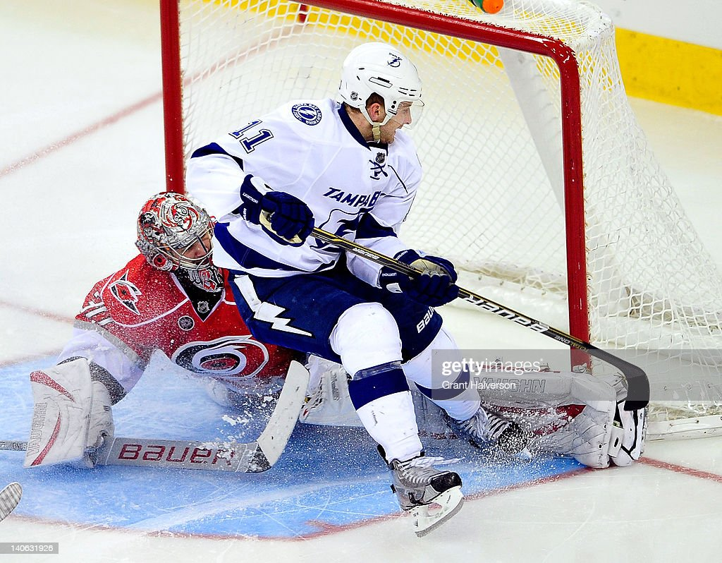 <a gi-track='captionPersonalityLinkClicked' href=/galleries/search?phrase=Tom+Pyatt&family=editorial&specificpeople=2079036 ng-click='$event.stopPropagation()'>Tom Pyatt</a> #11 of the Tampa Bay Lightning crashes into goaltender <a gi-track='captionPersonalityLinkClicked' href=/galleries/search?phrase=Cam+Ward&family=editorial&specificpeople=453216 ng-click='$event.stopPropagation()'>Cam Ward</a> #30 of the Carolina Hurricanes during play at the RBC Center on March 3, 2012 in Raleigh, North Carolina. The Lightning won 4-3 in overtime.