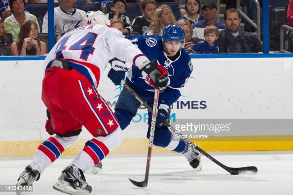 Tom Pyatt of the Tampa Bay Lightning passes the puck against Roman Hamrlik of the Washington Capitals during the first period at the St Pete Times...