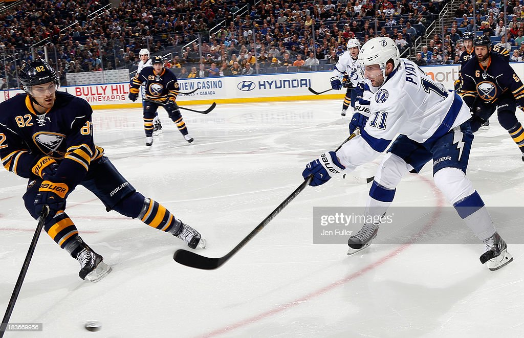 <a gi-track='captionPersonalityLinkClicked' href=/galleries/search?phrase=Tom+Pyatt&family=editorial&specificpeople=2079036 ng-click='$event.stopPropagation()'>Tom Pyatt</a> #11 of the Tampa Bay Lightning passes the puck around <a gi-track='captionPersonalityLinkClicked' href=/galleries/search?phrase=Marcus+Foligno&family=editorial&specificpeople=5662790 ng-click='$event.stopPropagation()'>Marcus Foligno</a> #82 of the Buffalo Sabres at First Niagara Center on October 8, 2013 in Buffalo, New York. Tampa defeated Buffalo 3-2.
