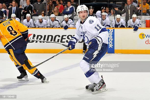 Tom Pyatt of the Tampa Bay Lightning plays against the Nashville Predators at Bridgestone Arena on September 24 2013 in Nashville Tennessee