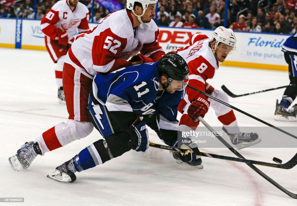 <a gi-track='captionPersonalityLinkClicked' href=/galleries/search?phrase=Tom+Pyatt&family=editorial&specificpeople=2079036 ng-click='$event.stopPropagation()'>Tom Pyatt</a> #11 of the Tampa Bay Lightning scores past <a gi-track='captionPersonalityLinkClicked' href=/galleries/search?phrase=Jonathan+Ericsson&family=editorial&specificpeople=2538498 ng-click='$event.stopPropagation()'>Jonathan Ericsson</a> #52 and <a gi-track='captionPersonalityLinkClicked' href=/galleries/search?phrase=Justin+Abdelkader&family=editorial&specificpeople=2271858 ng-click='$event.stopPropagation()'>Justin Abdelkader</a> #8 of the Detroit Red Wings at the Tampa Bay Times Forum on February 8, 2014 in Tampa, Florida.