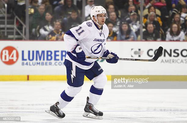 Tom Pyatt of the Tampa Bay Lightning skates against the Pittsburgh Penguins during the game at Consol Energy Center on March 22 2014 in Pittsburgh...