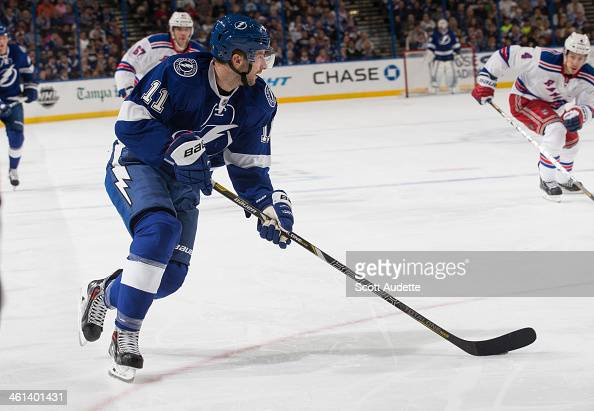 Tom Pyatt of the Tampa Bay Lightning skates with the puck against the New York Rangers at the Tampa Bay Times Forum on December 29 2013 in Tampa...