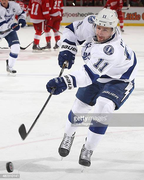 Tom Pyatt of the Tampa Bay Lightning takes a shot during warmups before an NHL game against the Detroit Red Wings on March 30 2014 at Joe Louis Arena...