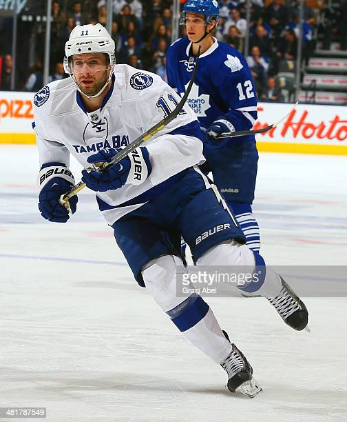 Tom Pyatt of the Toronto Maple Leafs of the Tampa Bay Lightning during NHL game action March 19 2014 at the Air Canada Centre in Toronto Ontario...