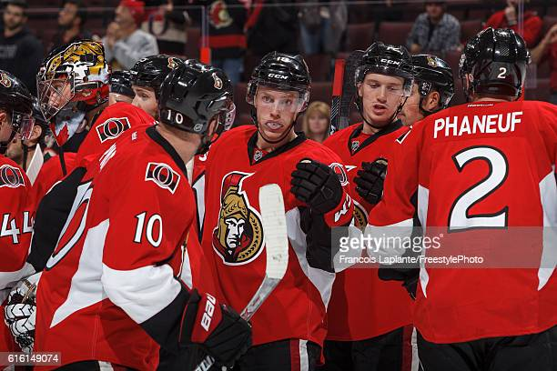 Tom Pyatt Ryan Dzingel Thomas Chabot and Dion Phaneuf of the Ottawa Senators celebrate their win over the Arizona Coyotes during an NHL game at...