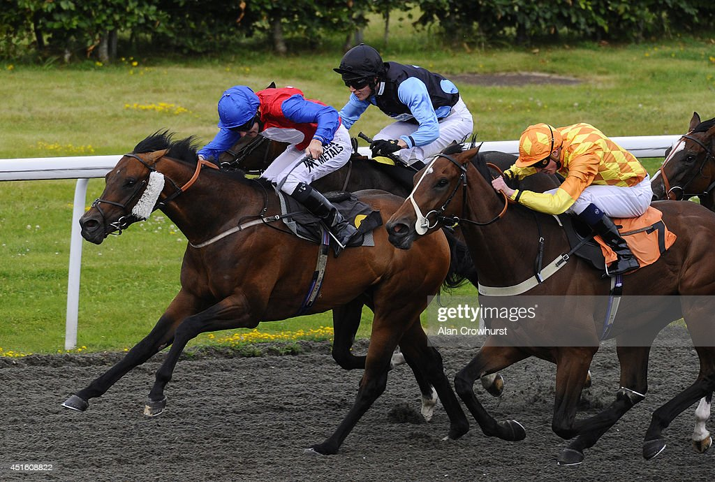 <a gi-track='captionPersonalityLinkClicked' href=/galleries/search?phrase=Tom+Queally&family=editorial&specificpeople=221256 ng-click='$event.stopPropagation()'>Tom Queally</a> riding Classic Pursuit (L) win The Jockey Club Handicap Stakes at Kempton Park racecourse on July 02, 2014 in Sunbury, England.