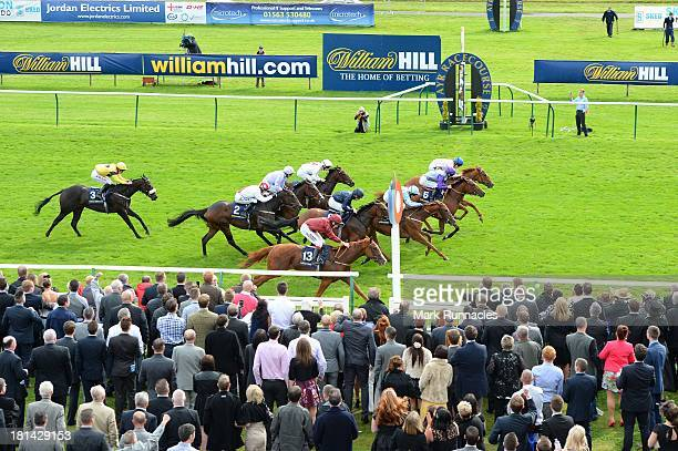 Tom Queally riding Coral Mist wins the the William Hill In The App Store Firth Of Clyde Stakes at Ayr racecourse on September 21 2013 in Ayr Scotland