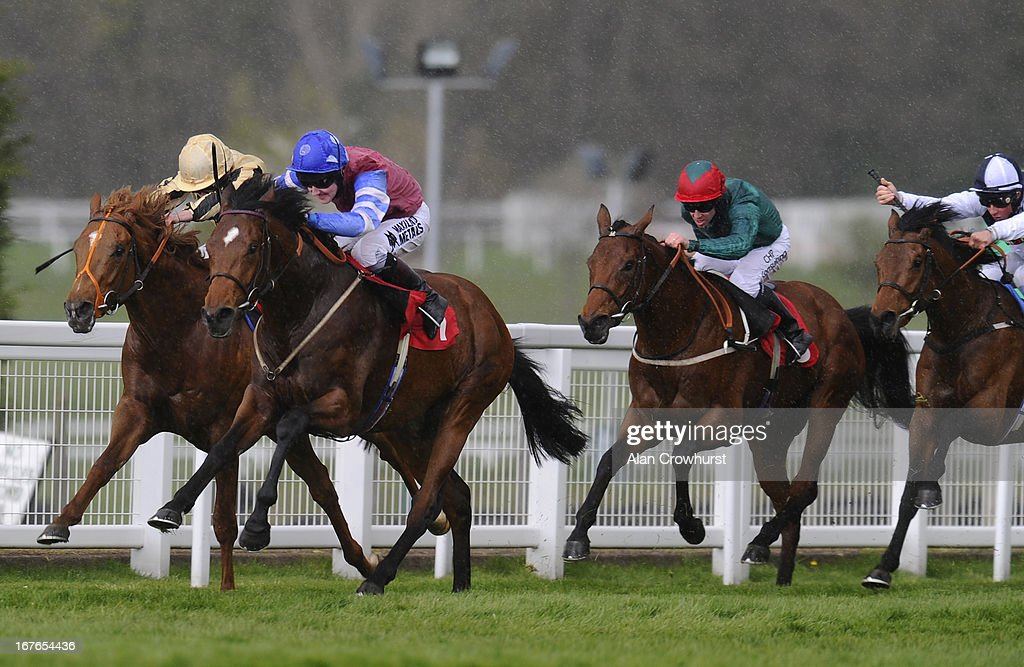 Tom Queally riding Spillway (2L) win The bet365 Handicap Stakes at Sandown racecourse on April 27, 2013 in Esher, England.