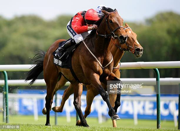 Tom Queally riding The Cheka win the Timeform Jury Stakes at Haydock racecourse on May 28 2011 in Haydock England