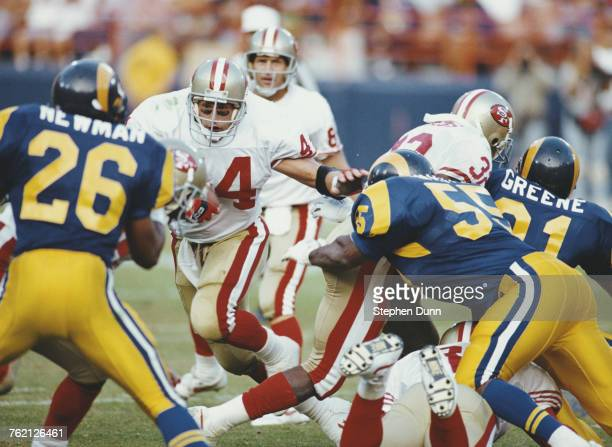 Tom Rathman Running Back for the San Francisco 49ers runs the ball against the Los Angeles Rams defence during their National Football Conference...