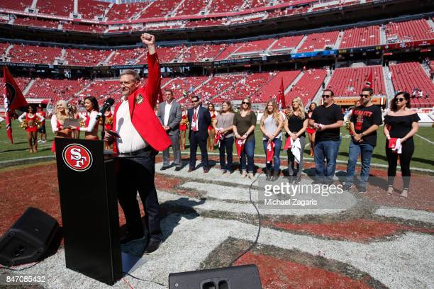 Tom Rathman saddress the crowd after being inducted into the San Francisco 49ers Hall of Fame during halftime of the game between the 49ers and the...