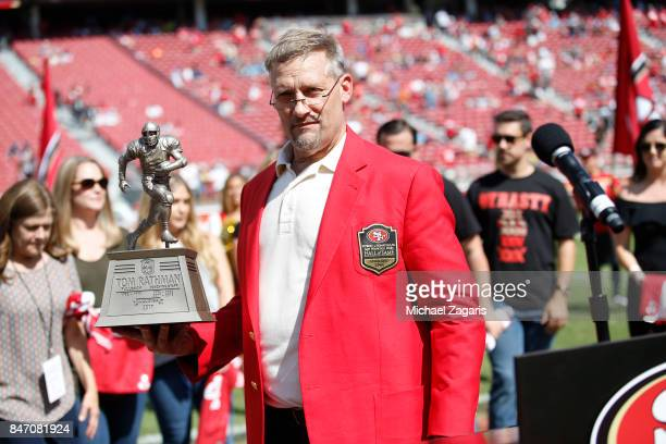 Tom Rathman stands on the field after being inducted into the San Francisco 49ers Hall of Fame during halftime of the game between the 49ers and the...