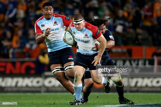 Tom Robertson of the Waratahs makes a break during the round 14 Super Rugby match between the Highlanders and the Waratahs at Forsyth Barr Stadium on...
