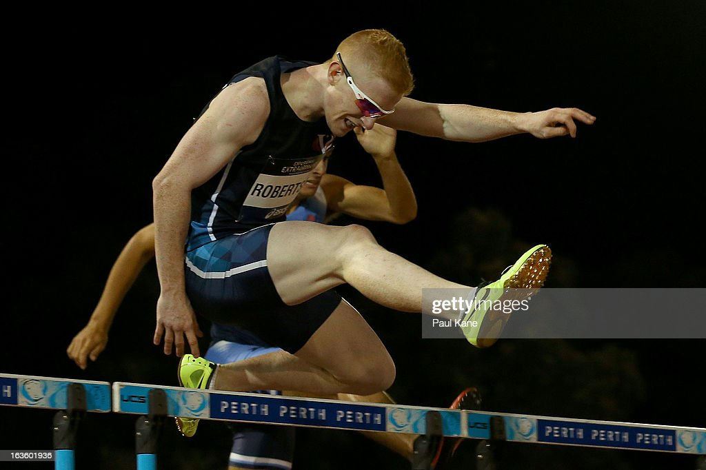 Tom Robertson of Victoria competes in the men's u20 400 metre hurdles final during day two of the Australian Junior Championships at the WA Athletics Stadium on March 13, 2013 in Perth, Australia.