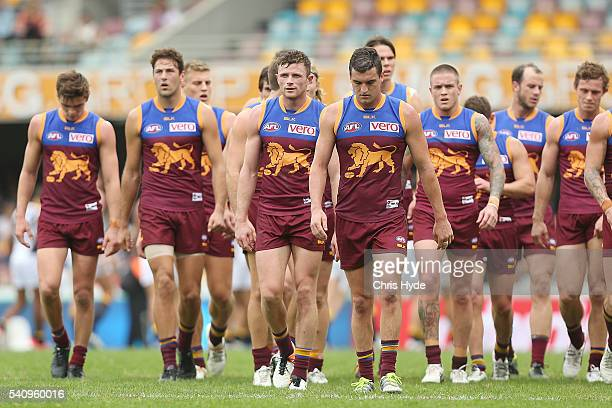Tom Rockliff and the Lions leave the field at half time during the round 13 AFL match between the Brisbane Lions and the West Coast Eagles at The...