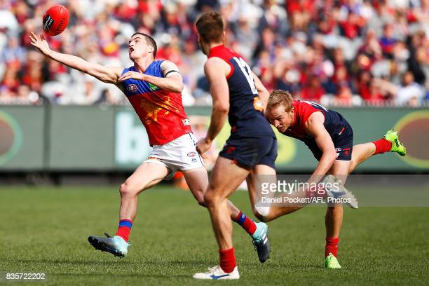 Tom Rockliff of the Lions attempts to mark the ball during the round 22 AFL match between the Melbourne Demons and the Brisbane Lions at Melbourne...