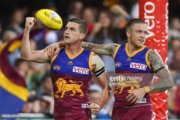 Tom Rockliff of the Lions celebrates a goal during the round 21 AFL match between the Brisbane Lions and the Gold Coast Suns at The Gabba on August...