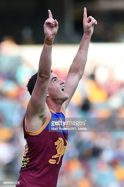 Tom Rockliff of the Lions celebrates victory during the round 23 AFL match between the Brisbane Lions and the Western Bulldogs at The Gabba on...