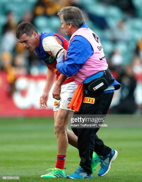 Tom Rockliff of the Lions comes off the ground injured during the 2017 AFL round 08 match between the Hawthorn Hawks and the Brisbane Lions at the...