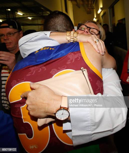 Tom Rockliff of the Lions is embraced by his mother after the 2017 AFL round 21 match between the Brisbane Lions and the Gold Coast Suns at the Gabba...