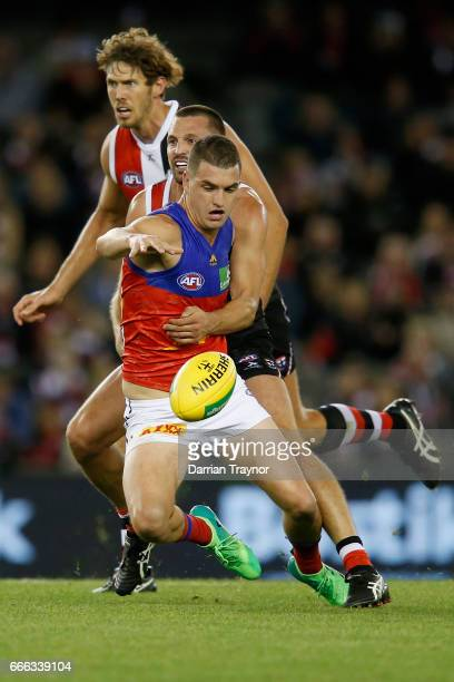 Tom Rockliff of the Lions is tackled by Jarryn Geary of the Saints during the round three AFL match between the St Kilda Saints and the Brisbane...