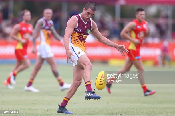 Tom Rockliff of the Lions kicks during the 2017 JLT Community Series match at Broadbeach Sports Centre on February 19 2017 in Gold Coast Australia