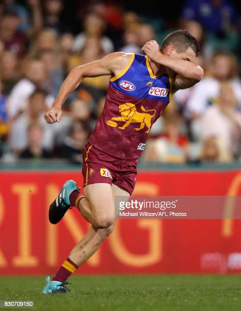 Tom Rockliff of the Lions kisses his black armbands after kicking a goal during the 2017 AFL round 21 match between the Brisbane Lions and the Gold...