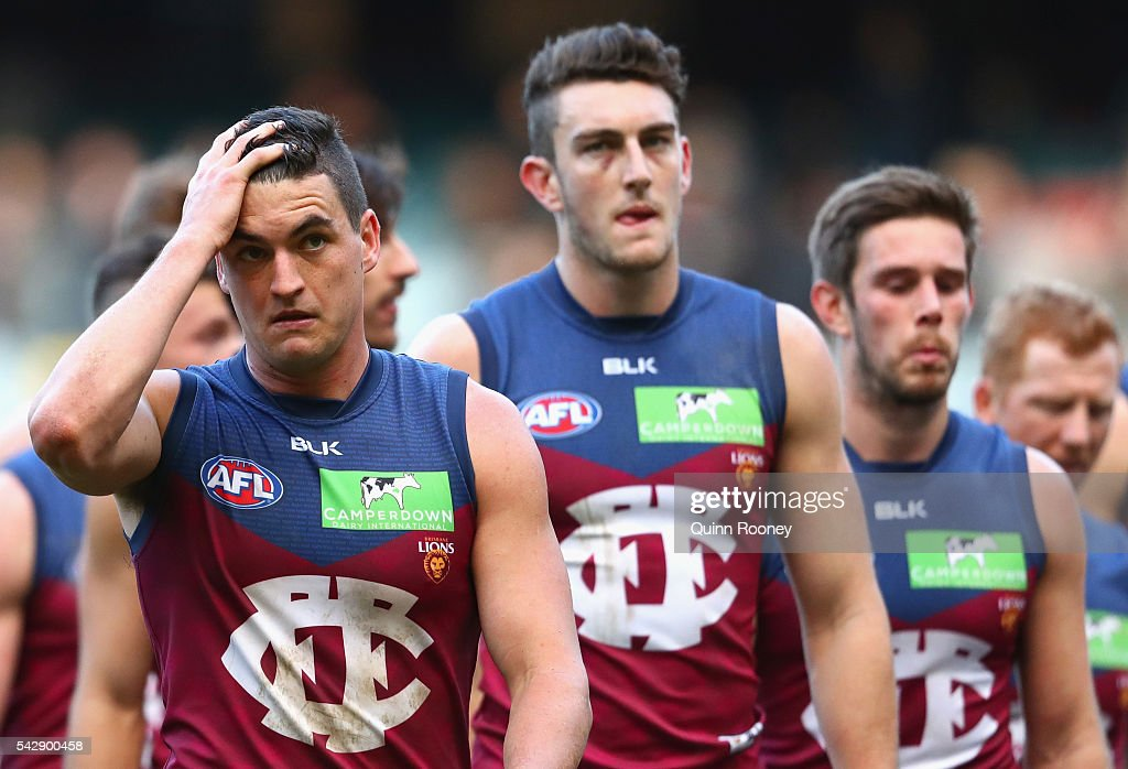 Tom Rockliff of the Lions looks dejected as the Lions leave the field after losing the round 14 AFL match between the Richmond Tigers and the Brisbane Lions at Melbourne Cricket Ground on June 25, 2016 in Melbourne, Australia.