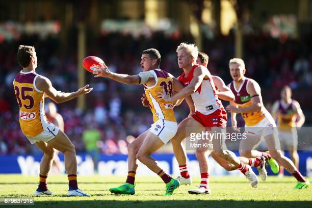 Tom Rockliff of the Lions reaches for the ball during the round seven AFL match between the Sydney Swans and the Brisbane Lions at Sydney Cricket...