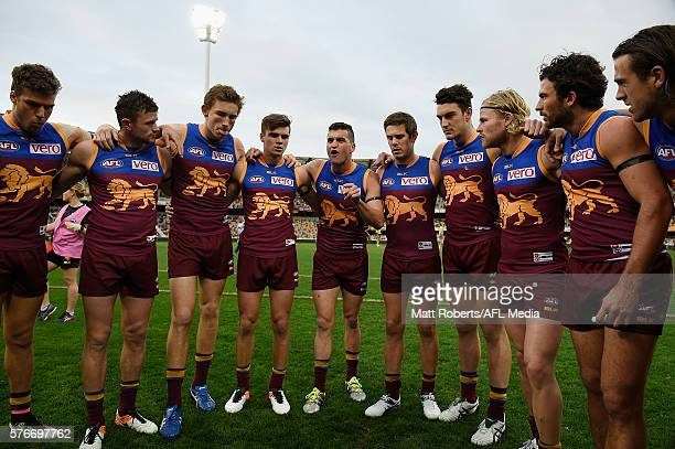 Tom Rockliff of the Lions speaks to his team mates during the round 17 AFL match between the Brisbane Broncos and the Greater Western Sydney Giants...