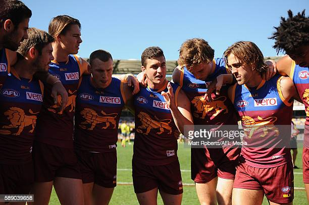 Tom Rockliff of the Lions speaks to his team mates in the huddle before the round 21 AFL match between the Brisbane Lions and the Carlton Blues at...