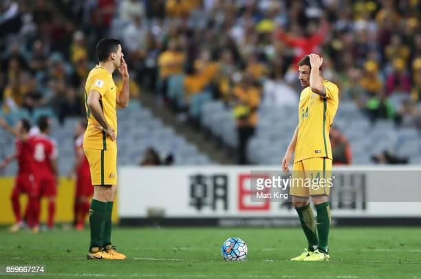 Tom Rogic and James Troisi of Australia look dejected after Syria's first goal during the 2018 FIFA World Cup Asian Playoff match between the...