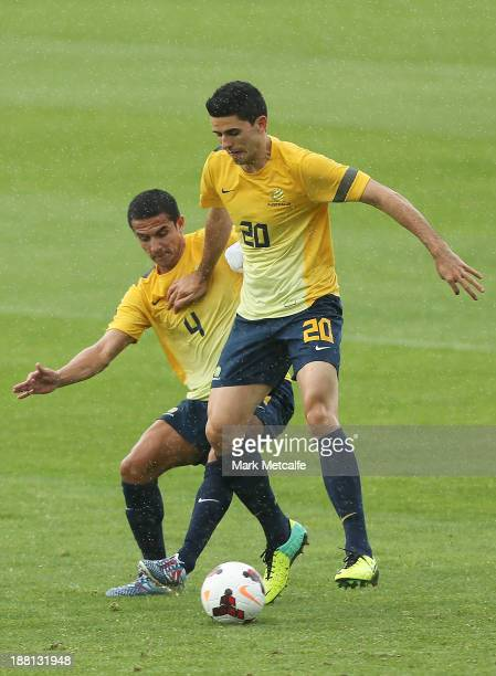 Tom Rogic is challenged by Tim Cahill during an Australian Socceroos training session at WIN Jubilee Stadium on November 16 2013 in Sydney Australia