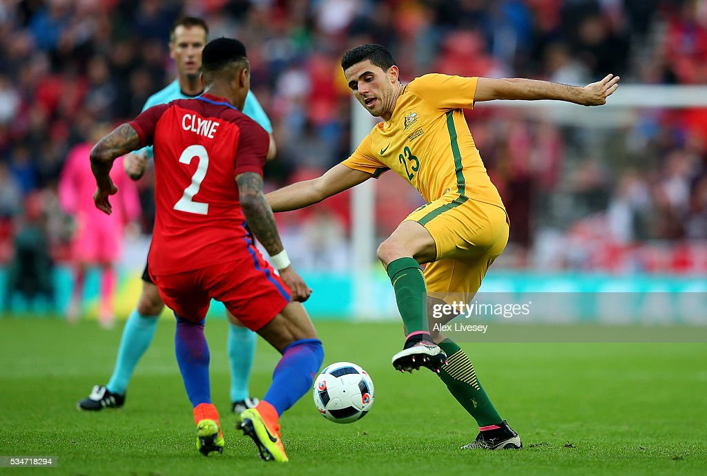 Tom Rogic of Australia and <a gi-track='captionPersonalityLinkClicked' href=/galleries/search?phrase=Nathaniel+Clyne&family=editorial&specificpeople=5738873 ng-click='$event.stopPropagation()'>Nathaniel Clyne</a> of England battle for a loose ball during the International Friendly match between England and Australia at Stadium of Light on May 27, 2016 in Sunderland, England.