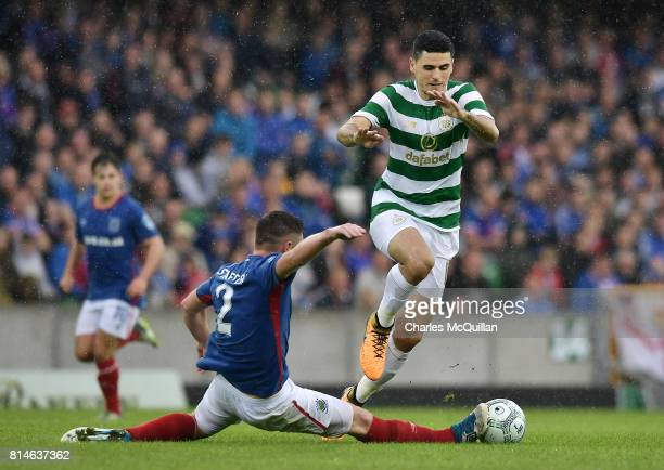 Tom Rogic of Celtic and Mark Stafford of Linfield during the Champions League second round first leg qualifying game between Linfield and Celtic at...