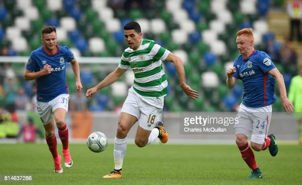 Tom Rogic of Celtic and Niall Quinn and Robert Garrett of Linfield during the Champions League second round first leg qualifying game between...