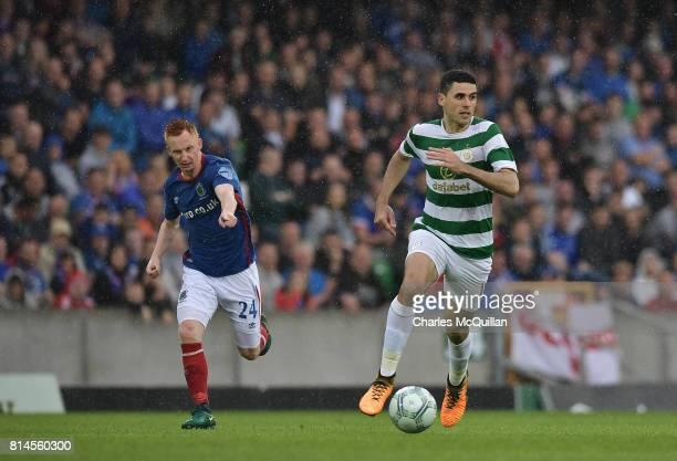 Tom Rogic of Celtic and Robert Garrett of Linfield during the Champions League second round first leg qualifying game between Linfield and Celtic at...