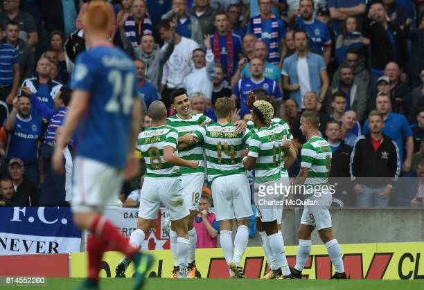 Tom Rogic of Celtic celebrates after scoring during the Champions League second round first leg qualifying game between Linfield and Celtic at...