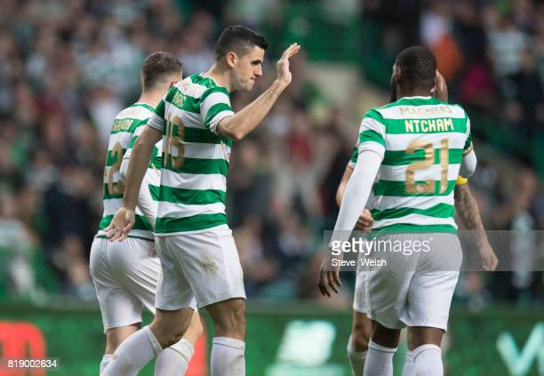 Tom Rogic of Celtic celebrates Celtic's 2nd goal with Olivier Ntcham during the UEFA Champions League Qualifying Second RoundSecond Leg match between...