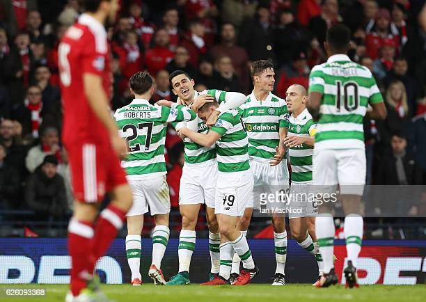 Tom Rogic of Celtic hugs James Forrest of Celtic after he scores his teams second goal during the Betfred Cup Final between Aberdeen and Celtic at...