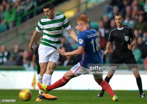 Tom Rogic of Celtic is challenged by Chris Casement of Linfield during the UEFA Champions League Qualifying Second Round Second Leg match between...